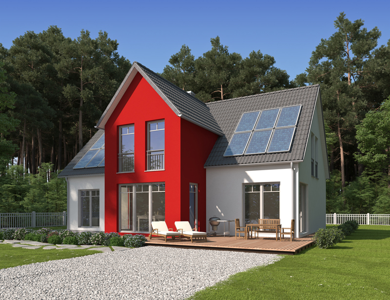 Haus am Waldrand mit rotem Erker